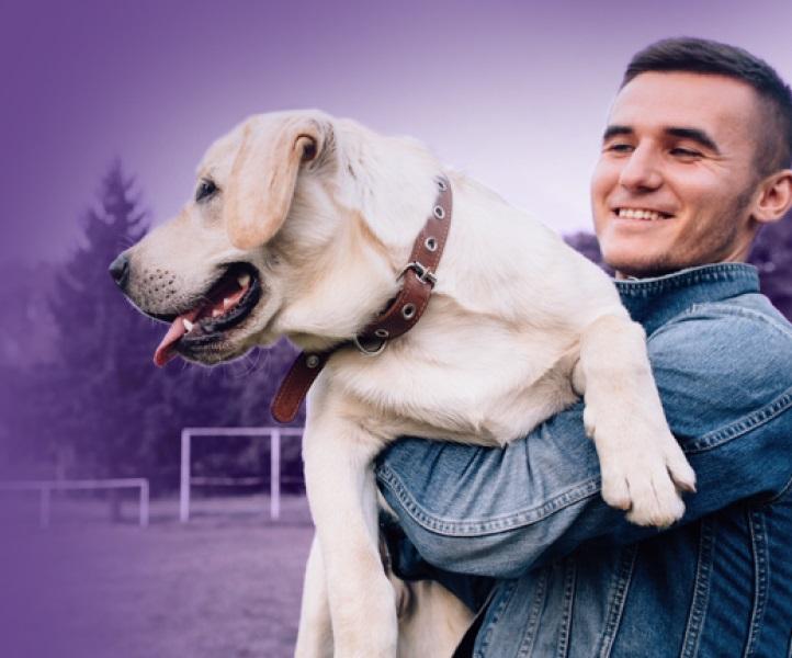 Man holding Dog Petbond Exclusive partner of Petfix