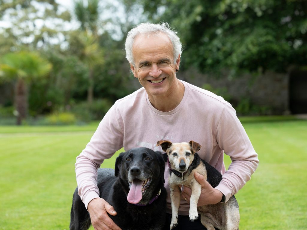 pete the vet with his dogs in the grass