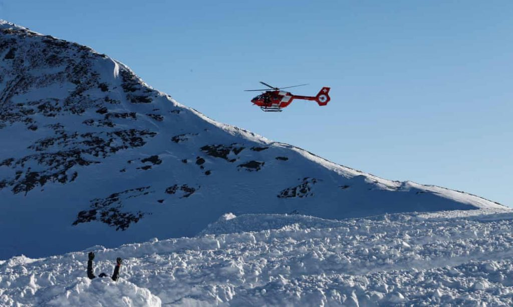 A helicopter of the Rega arrives during a life-saving exercise after avalanche at the Glacier 3000 in Les Diablerets, Switzerland in 2019. Photograph: Denis Balibouse/Reuters