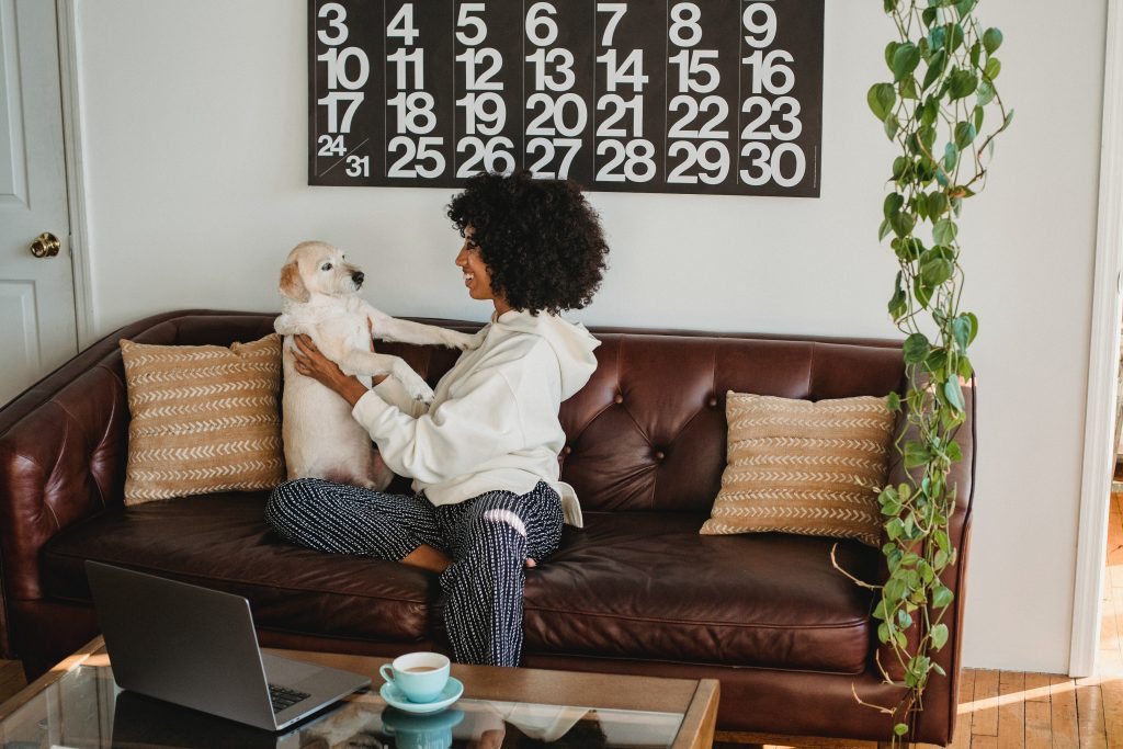 lady sitting in apartment with dog