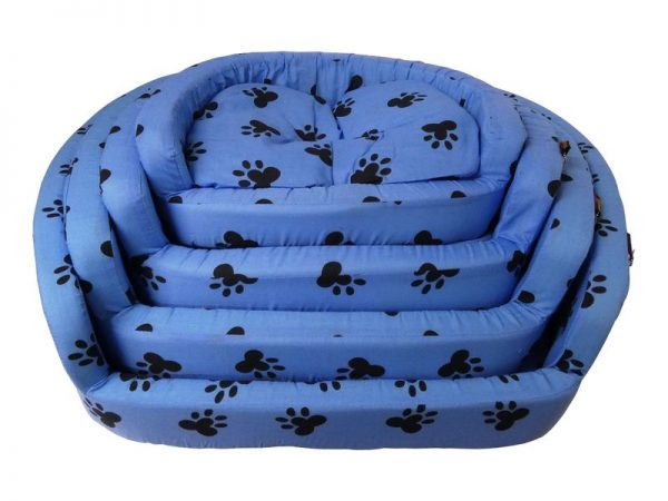 A comfortable blue bed for a pet, that looks like a sofa with a black paw print