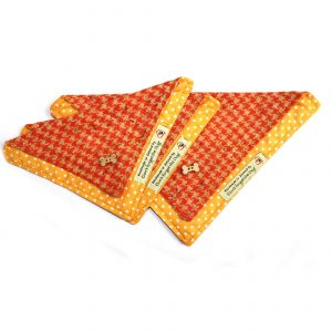 Orange bandana for dogs with yellow polka dot trimming